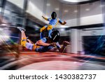 Small photo of I flying. Skydiving in wind tunnel. New skydiving sport in flight technology. Indoor skydiving. Training in wind tunnel. Surfing on people