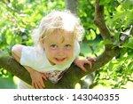 Smiling Child Climbing A Tree...