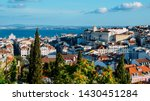 Small photo of Lisbon, Portugal cityscape overlooking Baixa downtown area. Visible landmarks include: Rua Augusta Triumphal Arch, Rossio, Santa Justa Elevator and Chiado with Tagus River at background