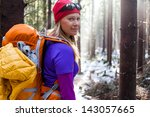 Woman Hiking In White Winter...