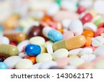 pile of many colorful pills and