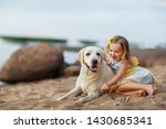 little girl with a labrador dog ... | Shutterstock . vector #1430685341