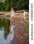little girl with a labrador dog ... | Shutterstock . vector #1430685344
