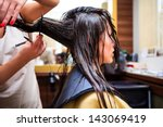 young woman at hairdresser | Shutterstock . vector #143069419