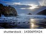 Sunset With Surf And Rocks At...