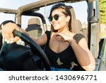 Confident Happy Woman Driving...