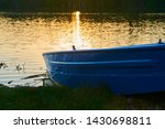 fishing boat in a calm lake... | Shutterstock . vector #1430698811