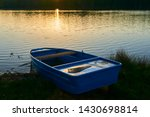 fishing boat in a calm lake... | Shutterstock . vector #1430698814