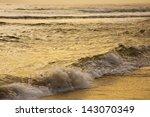 golden sunrise reflecting on... | Shutterstock . vector #143070349