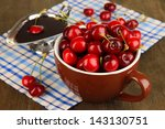 ripe red cherry berries in cup...   Shutterstock . vector #143130751