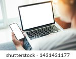 Stock photo mockup image blank screen computer cell phone with space for advertising text hand using laptop 1431431177