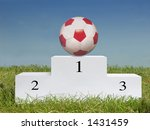 Soccer ball on first place podium - stock photo