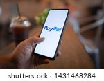 Small photo of CHIANG MAI, THAILAND - Mar. 24,2019: Man holding Xiaomi Mi Mix 3 with PayPal apps on the screen. PayPal is an online electronic payment system.