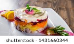Stock photo layered salad with herring beets carrots onions potatoes and eggs close up on a plate on wooden 1431660344
