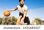 Athletic Male Basketball Playe...
