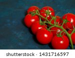 cherry tomatoes on a dark blue... | Shutterstock . vector #1431716597