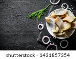 Stock photo fillet of salted herring with dill and chopped onion on black rustic background 1431857354