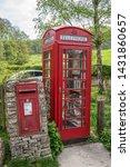 Red British Telephone Box And...