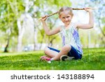 girl in the park sitting on the ...   Shutterstock . vector #143188894