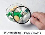 many multi colored pills. holds ... | Shutterstock . vector #1431946241