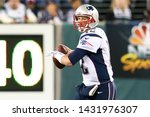 Small photo of EAST RUTHERFORD, NJ - NOV 22: New England Patriots quarterback Tom Brady looks to throw a pass against the New York Jets at MetLife Stadium on November 22, 2012 in East Rutherford, New Jersey.