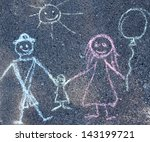 Children's drawing with chalk on the pavement, the family - stock photo