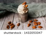 almond ice cream in can on... | Shutterstock . vector #1432053347