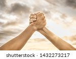 Small photo of Strong hands coming together grasping one another, helping hand. People working together, unity, teamwork