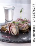 Stock photo bruschetta with herring on a plate and a glass with vodka closeup view selective focus 1432576247