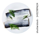 Stock photo two pieces of fresh appetizing atlantic herring on a white plate decorated with dill white 1432589624