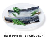 Stock photo two pieces of fresh appetizing atlantic herring on a white plate decorated with dill white 1432589627