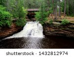 Covered bridge and Waterfall at Amnicon Falls State Park in Wisconsin