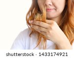 Small photo of Asain woman holding her long hairs that make color treatments. The hairs maybe have problem breakage (split end) .Should care or cut end of hairs. On white background.