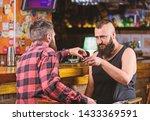 men relaxing at pub. strong... | Shutterstock . vector #1433369591