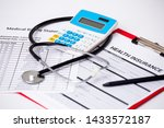 Health Care Costs. Stethoscope...