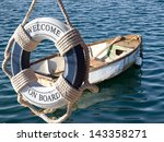 Old Wooden Boat On The Sea And...