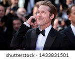 "Small photo of CANNES, FRANCE - MAY 21: Brad Pitt attends the premiere of the movie ""Once Upon A Time In Hollywood"" during the 72nd Cannes Film Festival on May 21, 2019 in Cannes, France."
