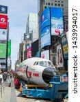 Small photo of New York, NY, USA - March 24,2019. The iconic CONNIE airplane on Times Square in New York at spring
