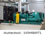 men working on diesel generator | Shutterstock . vector #1434486971