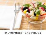 served fresh salad on bamboo...   Shutterstock . vector #143448781