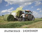 Farmer Changing The Roll Of...