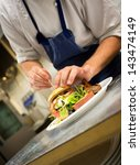 Detail Of A Chef Preparing A...