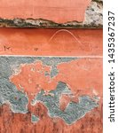 Small photo of ITALY, ROME - May 13 2019: a distressed ruined coral colored facade of the building located at Via di Santa Dorotea 15, Trastevere