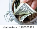 hand pulls one dollar banknote... | Shutterstock . vector #1435555121