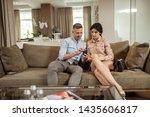 husband showing photo. handsome ...   Shutterstock . vector #1435606817