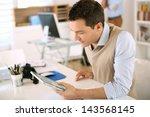 handsome guy working with...   Shutterstock . vector #143568145
