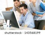 workteam in office working on...   Shutterstock . vector #143568199