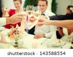 the clink of glasses. wedding... | Shutterstock . vector #143588554