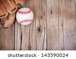 Baseball And Mitt On Rustic...