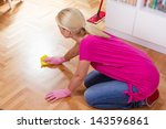 Woman cleaning and mopping floor at home. - stock photo